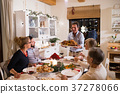Family celebrating Christmas. Father bringing food 37278066