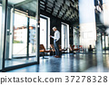 Mature businessman with smartphone in the office. 37278328