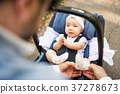 Father with baby daughter sitting in car safety 37278673
