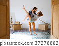 Man carrying woman in his arms, moving in new 37278882