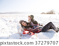 Mother with her daughter, playing in the snow. 37279707
