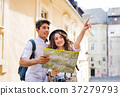 Two young tourists with map and camera in the old 37279793