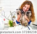 Ten years girl sitting with bunny 37280238