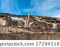 Damaged and Abandoned Roof 37294318