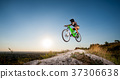 Cyclist riding downhill on mountain bike on the hill 37306638