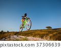 Cyclist riding downhill on mountain bike on the hill 37306639