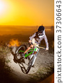 Cyclist riding downhill on mountain bike on the hill 37306643