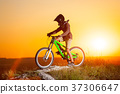Cyclist with mountain bike on the hill in the evening 37306647