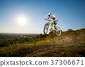 Cyclist riding downhill on mountain bike on the hill 37306671