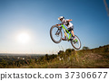 Cyclist riding downhill on mountain bike on the hill 37306677