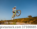 Cyclist riding downhill on mountain bike on the hill 37306685