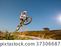 Cyclist riding downhill on mountain bike on the hill 37306687