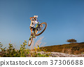 Cyclist riding downhill on mountain bike on the hill 37306688