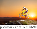 Cyclist riding downhill on mountain bike on the hill 37306690