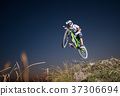 Cyclist riding downhill on mountain bike on the hill 37306694