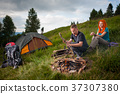 Young couple tourists traveling in the mountains 37307380