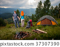 Young couple tourists traveling in the mountains 37307390