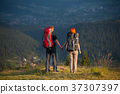 Young couple tourists traveling in the mountains 37307397