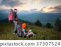 Young couple tourists traveling in the mountains 37307524