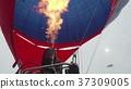 Hot air balloon. Burner directing flame into 37309005