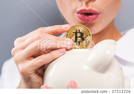 Woman with bitcoin and piggy bank 37313726