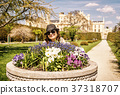 Tourist woman posing with flowerbed with Lednice 37318707