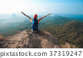 woman hiker enjoy the view on cliff edge  37319247