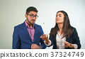 Business partners throw a coin a girl is surprised 37324749