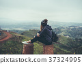Young woman traveler sitting and looking view 37324995