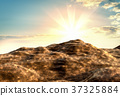 Background of brown clay soil and sky with clouds 37325884