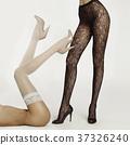 Slim female legs in pantyhose 37326240