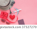 Flat lay man or women to plan travel in valentines 37327270