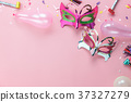 Flat lay purple silver carnival mask  37327279