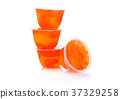 Single cups with mandarins in fruit jelly 37329258