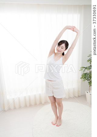 Stretching woman, arms, shoulders - Stock Photo [37330691] - PIXTA