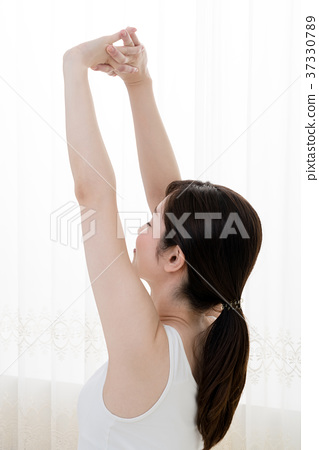 Stretching woman, arms, shoulders - Stock Photo [37330789] - PIXTA