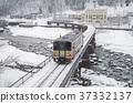 Oito Line A diesel car crossing Himekawa in winter 1 37332137
