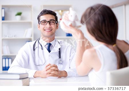 Vet doctor examining pet rabbit in clinic 37336717