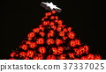Christmas tree of glowing balls with a shiny star 37337025