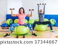 Sporty women training indoors doing exercise 37344667