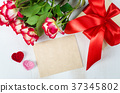 Empty greeting card, red roses and gift box 37345802