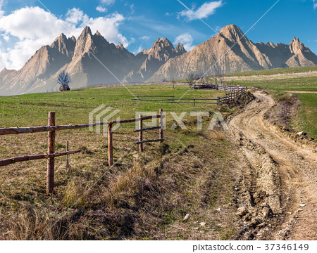 road through rural fields in mountainous area 37346149