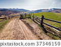 fence along the country road in rural area 37346150
