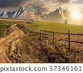 road through rural fields in mountains at sunset 37346161