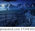 road through rural fields in mountains at night 37346163