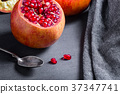 Sliced pomegranate with juicy red grains 37347741