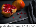 Sliced pomegranate with juicy red grains 37347745