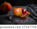 Sliced pomegranate with juicy red grains 37347746