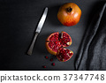 Sliced pomegranate with juicy red grains 37347748