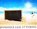 Blank black board on the Sand beach 002 37358445